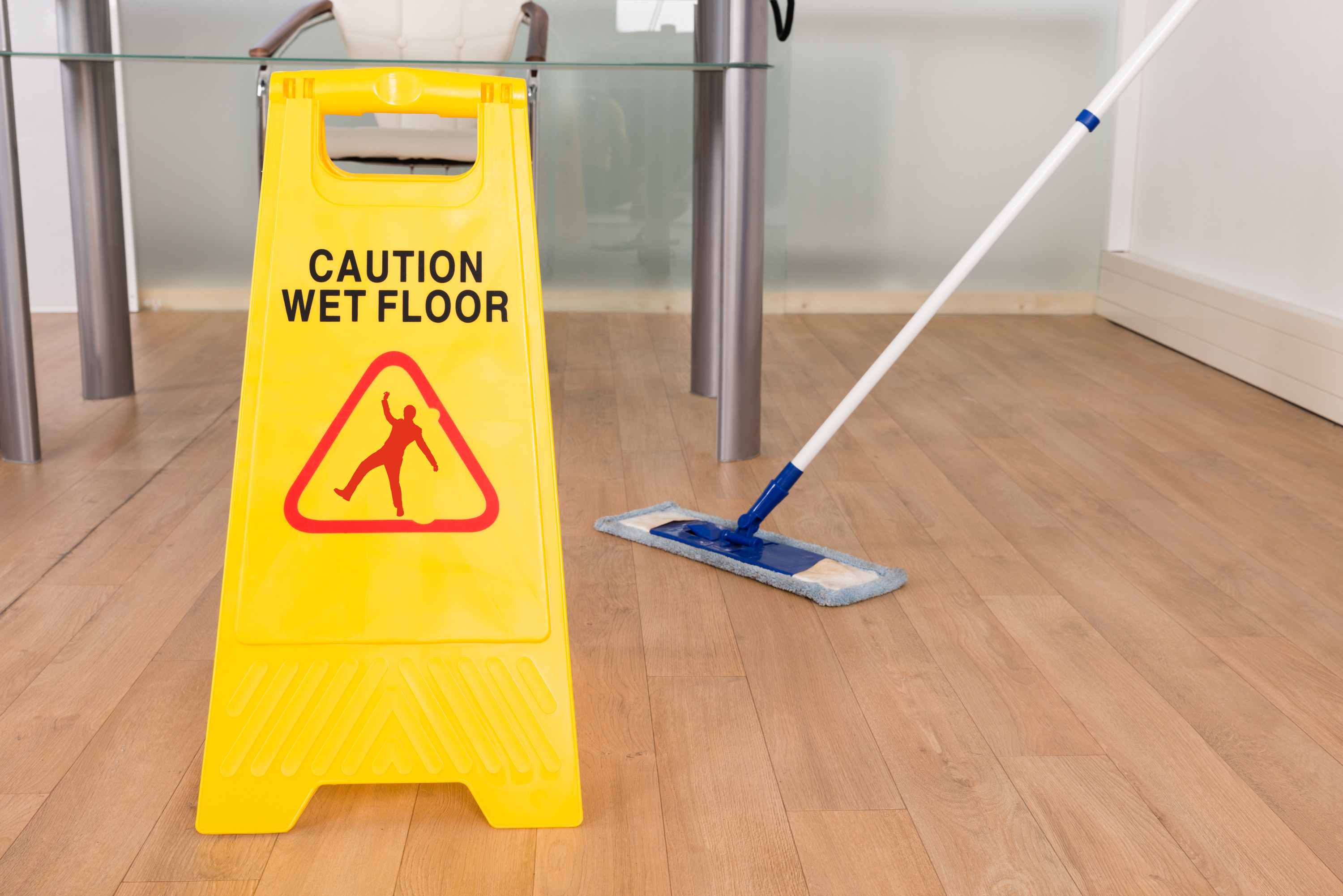 Caution wet floor sign on a wooden floor